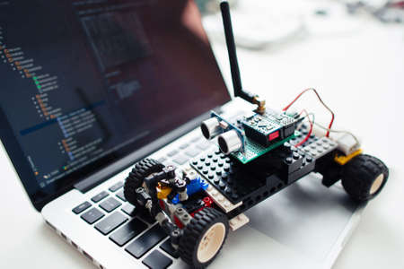 UKRAINE, KHARKIV- OCTOBER 1 ,2016. Diy rc car made on base of Arduino Pro Micro microcontroller and construction Lego Technic on laptop, close-up. Hobby, electronics, geek concept Editoriali