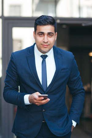 businesslike: Successful rich businessman outdoors. Handsome businesslike man in suit. Careerist and workaholic.