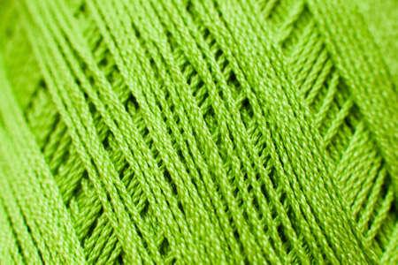 threaded: Green knitting thread texture, handiwork backdrop. Bright handiwork background, crochet iris string, Leisure, hobby, needlework concept