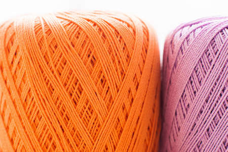 handiwork: Orange and purple knitting thread background. Bright handiwork backdrop, colorful crochet string, Leisure, hobby, needlework concept Stock Photo