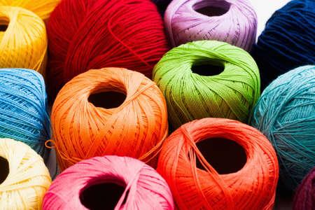 handiwork: Colorful yarn of balls background. Bright knitting thread texture. Handiwork, leisure, hobby concept Stock Photo