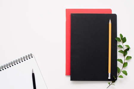text free space: Black and red notepads with open one, free space. Writer stuff on white background, free space for text. Artist, journalist, manager work tools.