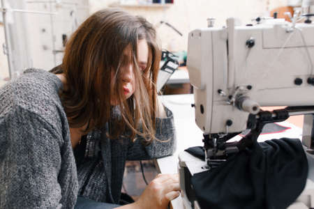 garment industry: Seamstress Tailor Garment Overwork Stress Industry Fashion Tiredness Concept
