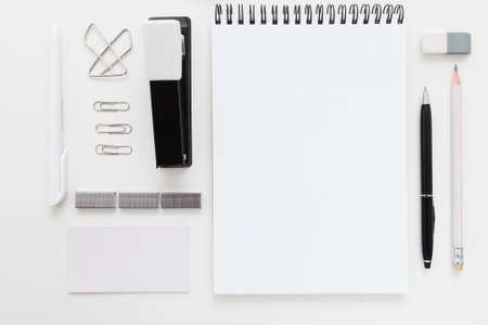 Black and white stationery set free space flat lay. Top view on white desk with office supplies, mockup. Business, worktools, education, accessories concept
