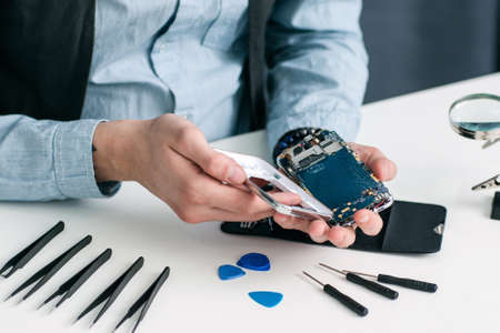 broken strategy: Smartphone Repair Shop Tool Electronic Technology Small Business Communication Fix Concept Stock Photo