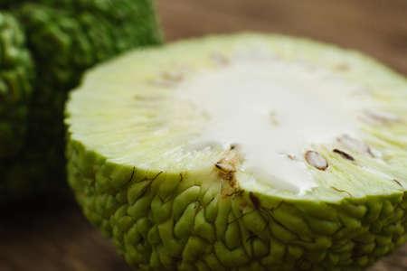 hedgeapple: Cut exotic green Adams apple fruit closeup. Macro photo of half of osage orange. Tropical treatment, alternative medicine, pharmacology concept
