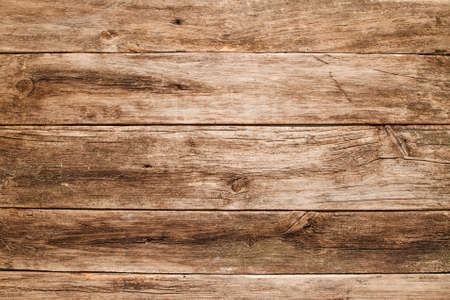 Empty grungy wooden table flat lay. Rustic used shabby table texture, free space for text or advertisement