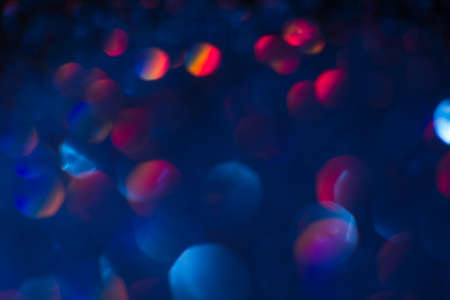 decoraton: Abstract blur light bokeh, blue and red. Blurred glittering shine , night background. Christmas wallpaper decorations concept. New year holiday festive backdrop. Sparkle circle celebrations display.