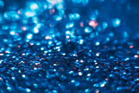 Abstract shining glitters blue makeup background. Blurred multicolored tinsel, selective focus with shallow depth of field. Glisten foil backdrop, christmas magic , eyeshadow closeup concept Stock Photo