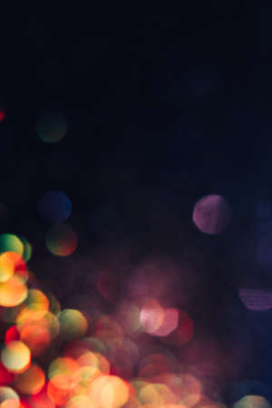 Abstract blurred light background, colorful lens flare. Glitter in bokeh. Christmas wallpaper decorations concept. New year holiday festive backdrop. Sparkle circle celebrations display.