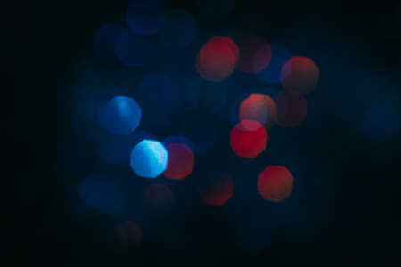 Abstract blurred glittering shine, teal and red. Blur light bokeh, night background. Christmas wallpaper decorations concept. New year holiday festive backdrop. Sparkle circle celebrations display.