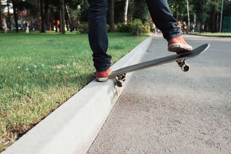 Skateboarder make back slide trick on the park. Practice of holding skate balance. Lifestyle Workout Leisure Fun Concept