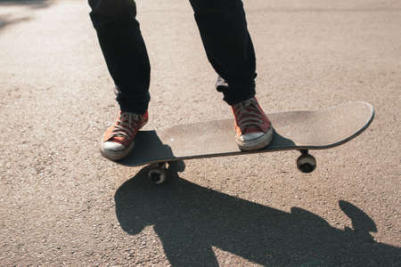 Manual ride trick. Holding balance exercise. Freestyle practice of skateboardering on downtown.