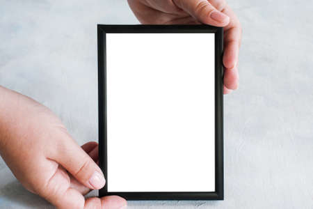 tenderly: Picture frame tenderly holding in hands. Greetings, concept of tendance and family memories, close up with copy space