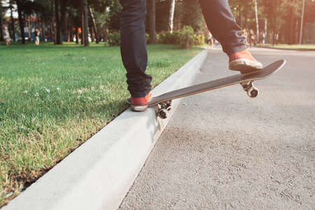 Skateboarding tricks of young hipster man. Extreme sport challenge and competition, readiness for adventure and self-confidence, free space