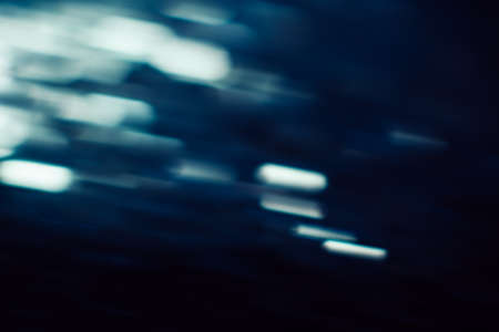 Abstract background of defocused white lights motion blur. Glowing urban backdrop, heavy night illumination city glimmers, bokeh Stock fotó - 85364520