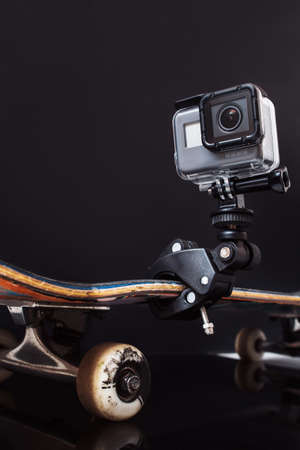 Kharkov, Ukraine - June 29, 2017: GoPro Hero5 fixed on skateboard on black background. Professional camera for action shooting of extreme sport competitions and tricks, free space Editorial