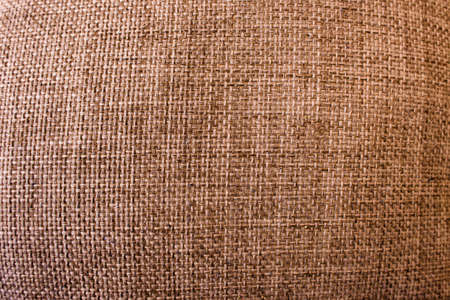Rustic cloth texture. Abstract background top view. Brown fabric backdrop with free space, color textile material closeup Фото со стока