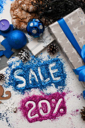 Sales on Christmas and New Year holidays, top view reversed. Colorful decoration with informative inscription of 20 pct discount for shop-windows, shopping malls and advertizing background concept