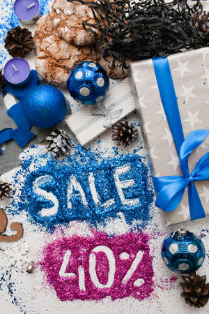 Sales on Christmas and New Year holidays, top view. Festive decoration with informative inscription of 40 pct discount for shop-windows, shopping malls and advertizing background concept