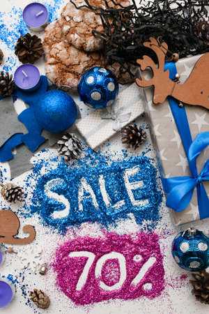 pct: Sales on Christmas and New Year holidays, top view reversed. Festive decoration with informative inscription of 70 pct discount for shop-windows, shopping malls and advertizing background concept