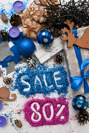 Sales on Christmas and New Year holidays, top view reversed. Festive decoration with informative inscription of 80 pct discount for shop-windows, shopping malls and advertizing background concept Stock Photo