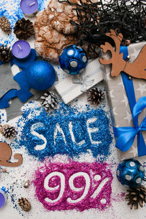 pct: Sales on Christmas and New Year holidays, top view reversed. Festive decoration with informative inscription of 99 pct discount for shop-windows, shopping malls and advertizing background concept