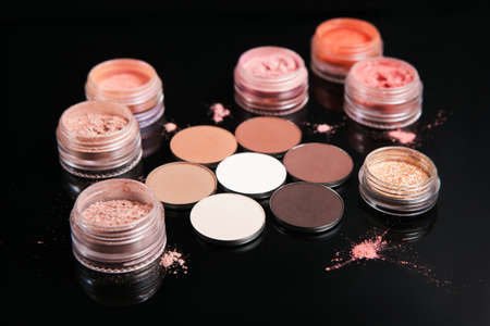 Professional set of cosmetics on black background, close up. Neutral colors for nude make up