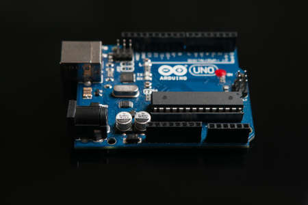 Kharkov, Ukraine - March 21, 2017: Arduino UNO board on black background, close up. Microcontroller for programming and prototyping