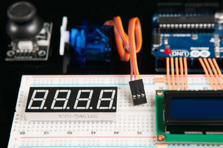 Kharkov, Ukraine - March 21, 2017: Arduino UNO board with electronic components, close up. Microcontroller for programming with KYX 5461as LED display