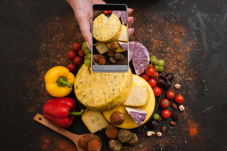 Food photography of rustic dairy. Cheese top view. Social networks and culinary blog concept 版權商用圖片