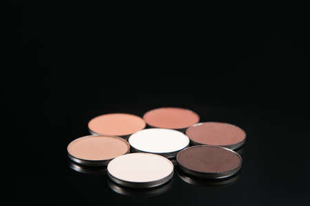 Professional nude make up set of cosmetics, top view free space. Strobing and contouring, eyeshadow beauty concept