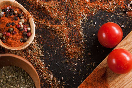 Spices. Culinary, cuisine, recipe background. Variety of pepper on black table, free space and closeup. Menu, blog concept