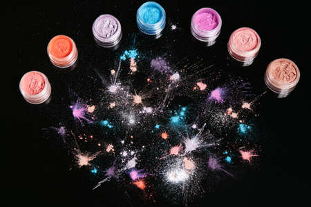 Professional abstract pigment cosmetics background, top view. Assortment of colorful powdery eyeshadow and colourants for creative make up