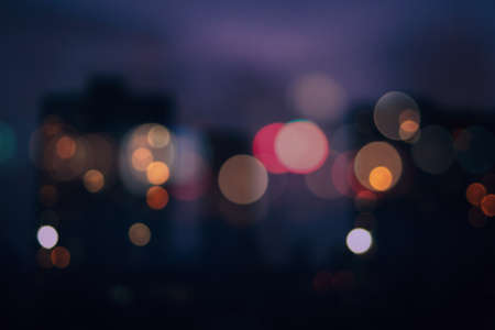 Bokeh urban blurring colours concept. Lights of residential areas. Abstract background. Stock Photo
