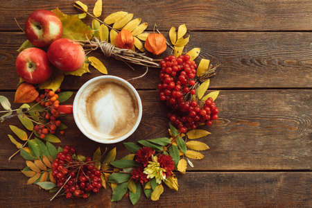 Autumn harvest. Fall leaves and berries assortment background. Hot beverage concept Stock Photo
