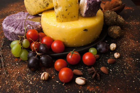 Cheese assortment. Dairy milk products set. Healthy food with variety of vegetables around