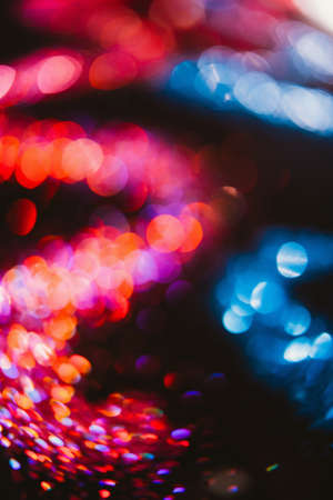 Abstract wavy sparkling glitter on contrast black background. Defocused bokeh concept Stock Photo