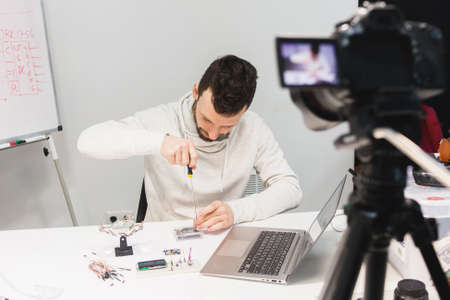 video tutorial creation filming backstage concept. passionate about work. Assembly of mechatronics.