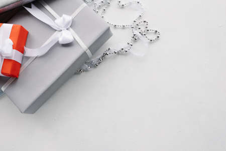 luxury jewelry gifts for top class on grey background. professional present wrapping for toffs on birthday, new year, christmas, thanksgiving, valentines day and other holidays. Foto de archivo