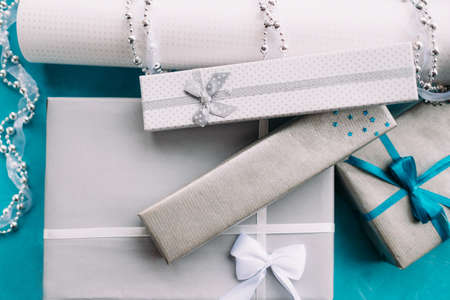 Gift boxes with jewelry presents inside. Tasteful wrapping concept Archivio Fotografico