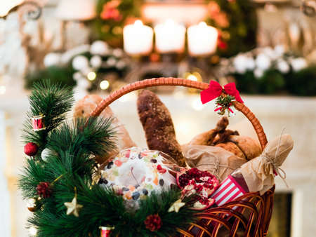 Christmas goods in a basket. Festive holiday food gift concept