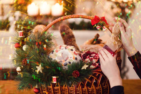Christmas goods in a basket. Delicious festive holiday food. Great present on different holidays.