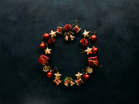 Christmas wreath of toys on dark background. Atmosphere of winter holidays.