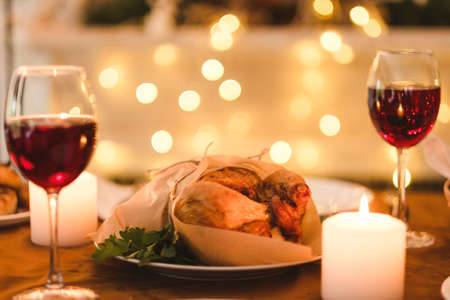 Romantic Homemade Evening Family Dinner Concept. Kitchen Traditions.  Delicious Holidays Food And Bright Lights