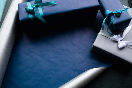expensive luxury present for rich men on dark background. professional gift wrapping. worthy surprise for bithday, fathers day, valentines day, new year, christmas, thanksgiving and other holidays. 스톡 콘텐츠