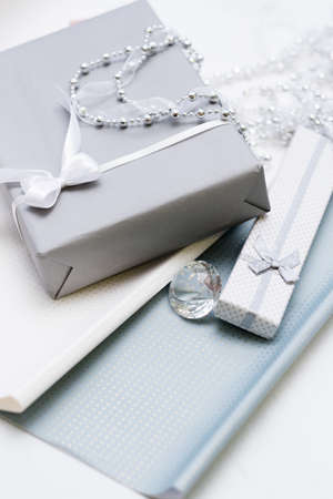 Gift boxes with jewelry presents inside. Tasteful wrapping concept 스톡 콘텐츠