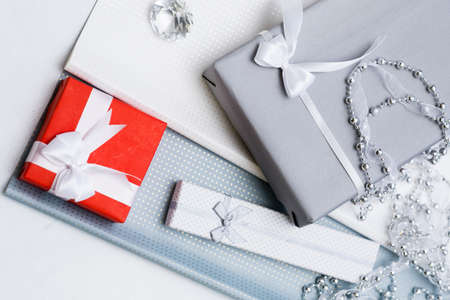 luxury jewelry gifts for top class on grey background. professional present wrapping for toffs on birthday, new year, christmas, thanksgiving, valentines day and other holidays. Standard-Bild