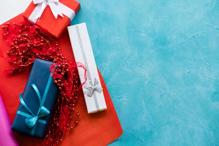 holidays gift assortment on bright blue background. game of contrasts. present wrapping for birthday, new year, christmas, thanksgiving, valentines day and other occasion.