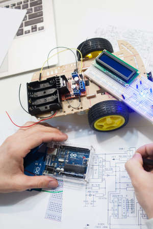 Ukraine, Kharkiv, 05.03.2017. Arduino Uno is a microcomputer that has its own memory and processor. The breadboard is designed to create prototypes of electronic devices.